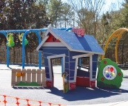 The inclusive playground at Trailhead Park in Tega Cay features a playhouse with widened entrances for access (photo: Ashley Holbert).