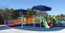 The inclusive playground at Trailhead Park in Tega Cay is equipped with rubberized flooring to minimize the risk of injury during play (photo: Ashley Holbert).