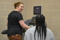 Kat West, a Winthrop psychology professor, and Ryan Earle, a student trainer, engage in conversation during the warm-up portion of the session (photo: La J'ai Reed).
