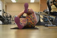 Kat West, a Winthrop faculty member, stretches to display her level of flexibility during a break between workouts with Ryan Earle, a student trainer (photo: La J'ai Reed).