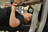 Ryan Earle, a senior exercise science major, assists Dr. Kat West while completing a bench press during a one-on-one training session (photo: La J'ai Reed).