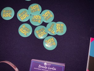 """Students for Life handed out buttons that said """"reverse Roe"""" at the screening of the controversial anti-abortion film """"Unplanned"""" at Dina's Place on the Winthrop campus (photo: Raili Burton)."""