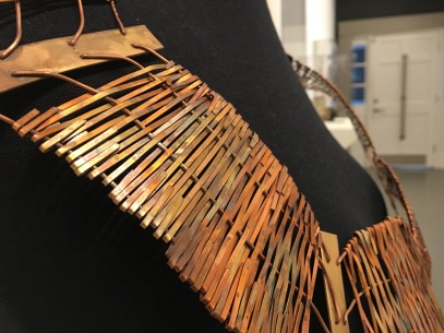 """University of Iowa alum Hannah Dufie Sakyiama displays """"My Piece,"""" a neckpiece inspired by Anansi, at the annual jewelry and metals exhibition at Winthrop's Lewandowski Student Gallery (photo: Yashuri Del Rosario Rodriguez)."""