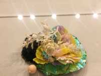 """Studio artist Nikki Couppee from Emeryville, Calif. displays her """"Floral Brooch"""" at the annual jewelry and metals exhibition at Winthrop's Lewandowski Student Gallery (photo: Yashuri Del Rosario Rodriguez)."""