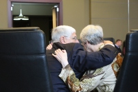 Trustees Jane LaRoche and Gary Williams embrace following her dissent during the board of trustees meeting Jan. 31 (photo: Anna Sharpe).