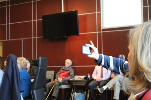"""Dr. Michael Lipscomb (out of frame), professor of political science and former faculty representative to the board of trustees, began recording trustee Jane LaRoche's comments. She called the process of appointing Hynd """"a huge mistake"""" (photo: Anna Sharpe)."""