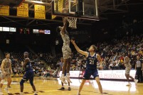 A Winthrop player goes up for a dunk during game against UNC Asheville Feb. 1. (photo: Tate Walden).
