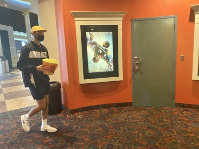 "Bryan Jackson heads into a theatre at the Regal Manchester movie theatre in Rock Hill, S.C. to watch the film ""Tenet"" after the theatre reopened Aug. 28 after being closed for months due to the COVID-19 pandemic (photo: Jendaya Fleming)."