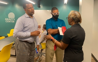 Dawn Johnson (right), a board member of the Gravity Center, speaks with guests after the ribbon cutting ceremony Sept. 9 for the group's new building in Rock Hill (photo: JaKayla Cornish).