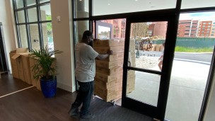A mover hired by the Nest delivers furniture that was delayed. The Nest said the missing tables and barstools were delayed because of a supply and demand issue, which was happening all over the U.S. (photo: Gabe Corbin).