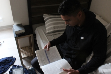 Roderick Washington, a senior at Winthrop University, studies on his bed prior to the furniture installation. He said the Nest was transparent with updates about the missing furniture, but he said he wished that the furniture would have been there when he moved in (photo: Gabe Corbin).