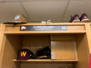 Winthrop assistant baseball coach Chris Clare has his name plate attached to his brand new locker in the coaches locker room (photo: Joey Tepper).