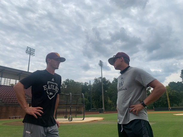 Winthrop Assistant baseball Coach Chris Clare (right) offers junior infielder Will Martin some tips on the mental side of the game prior to practice Sept. 15 at the Winthrop Ballpark (photo: Joey Tepper).