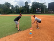 Winthrop Assistant baseball Coach Chris Clare (left) offers junior infielder Will Martin some tips on base running prior to practice Sept. 15 at the Winthrop Ballpark (photo: Joey Tepper).