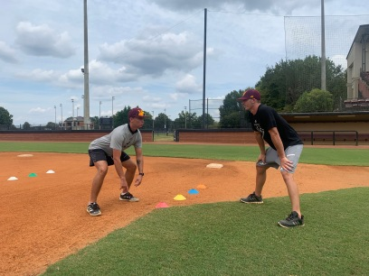 Winthrop Assistant baseball Coach Chris Clare (right) offers junior infielder Will Martin some tips on base running prior to practice Sept. 15 at the Winthrop Ballpark (photo: Joey Tepper).