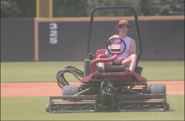 Winthrop assistant baseball coach Chris Clare cuts the grass, which is one of the many duties for an assistant coach, prior to a workout Aug. 28 at the Winthrop Ballpark (photo: Joey Tepper).