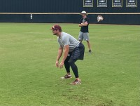 Winthrop assistant baseball coach Chris Clare supervises outfielders during a workout Aug. 15 at the Winthrop Ballpark (photo: Joey Tepper).