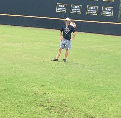 Winthrop assistant baseball coach Chris Clare watches over infielders getting loose during a September workout at the Winthrop Ballpark (photo: Joey Tepper).